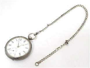 A Victorian silver pocket watch with enamel dial signed