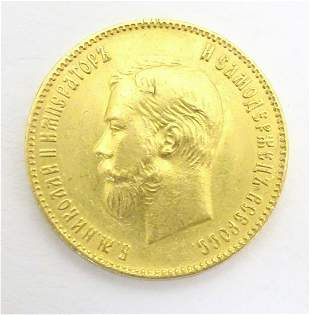 Coin: A gold 1901 ten / 10 rouble coin, depicting a