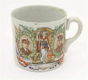 Militaria: an early 20thC ceramic mug with First World
