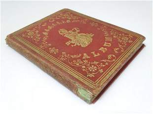 A Victorian memento album with tooled red leather