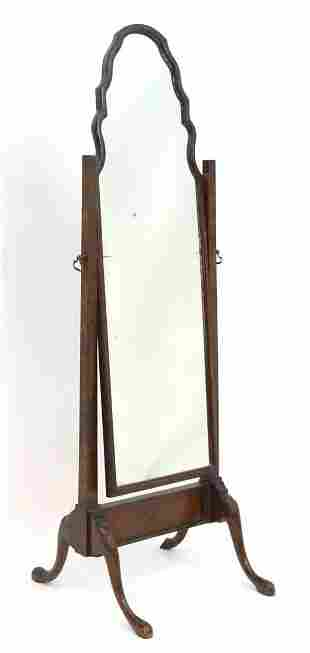 An early 20thC walnut cheval mirror in the Queen Anne