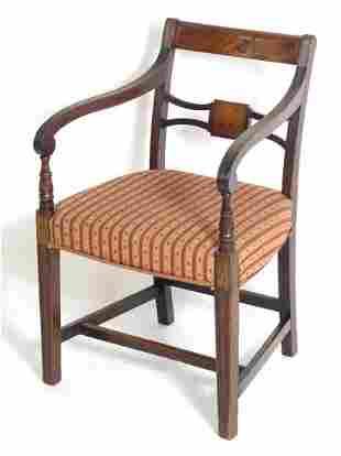 A Regency mahogany carver chair with a flame mahogany