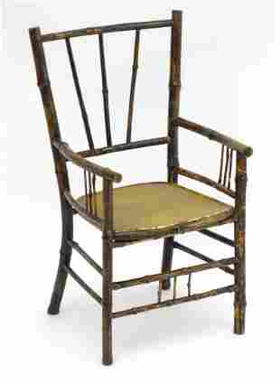 A late 19thC Aesthetic movement child's chair with a