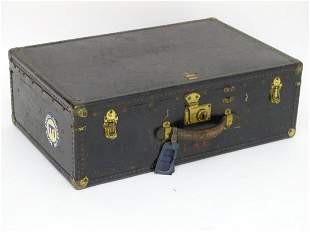 An early 20thC Oshkosh steamer trunk. the leather and