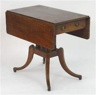 A Georgian oak Pembroke table with drop flaps, a