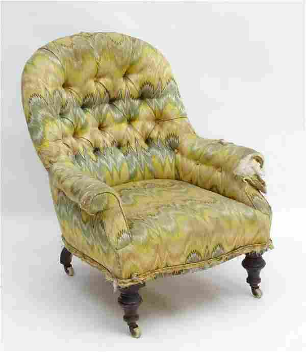 A late Victorian button back chair with sabre back legs