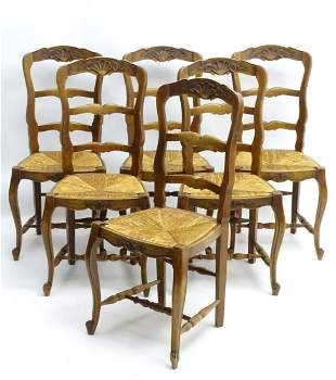 A set of early / mid 20thC oak dining chairs with