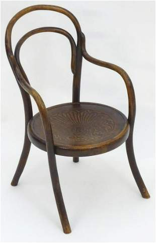 An early 20thC beech bentwood childs chair with an