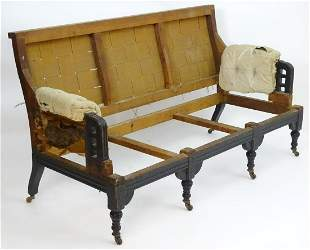 A late 19thC Aesthetic movement sofa with an ebonised