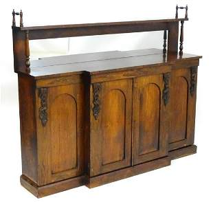 A 19thC rosewood sideboard having a shelf mounted by