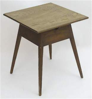 An early 20thC Arts & Crafts style oak occasional table