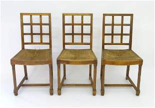 Three early 20thC oak Heals Tilden chairs with