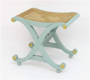 A Regency style painted X frame stool with gilt