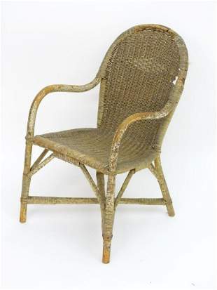 An early 20thC Dryad childs chair of wicker and