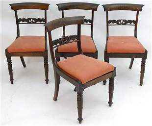 A set of four William IV rosewood dining chairs with