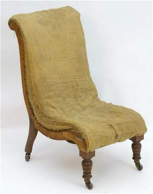 A Victorian slipper chair for re upholstery, standing