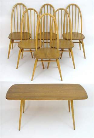 A vintage retro Ercol dining table and set of six