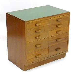 A mid 20thC cedar chest of drawers, comprising two