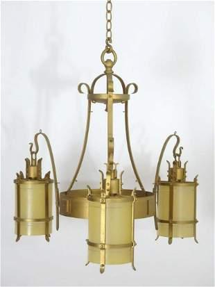 A 20thC Arts & Crafts style pendant gilt ceiling light,