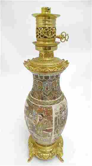 An early 20thC Satsuma vase table light, with ornate