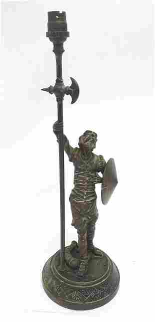 A Victorian cast figural table lamp, formed as Don