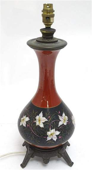 A Victorian table lamp, the ceramic body with red and