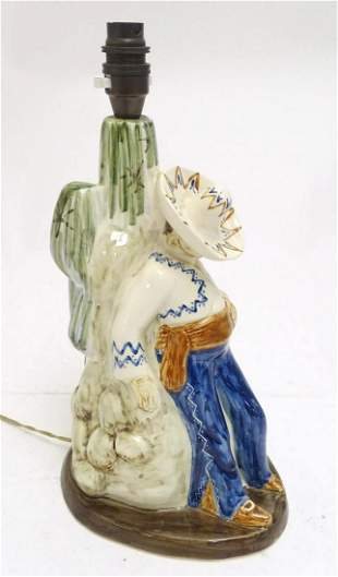 A mid 20thC figural ceramic table lamp by Jersey