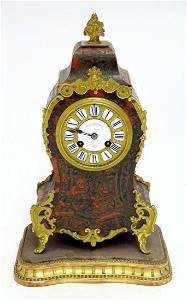 A 19thC French tortoiseshell Boulle work mantle clock