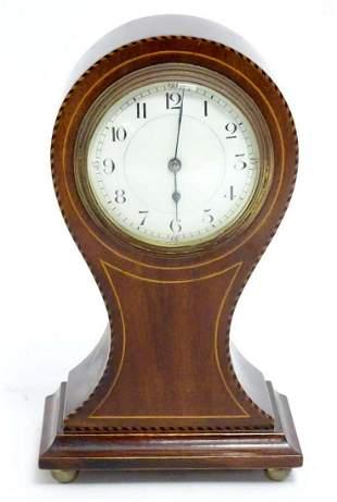 A 20thC balloon shaped mantel clock, the mahogany case