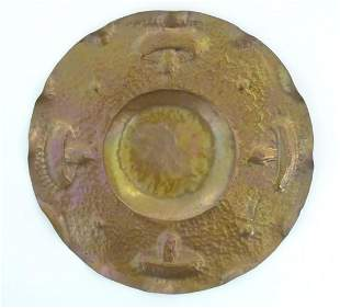 An Arts & Crafts hammered copper tray of circular form