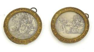 A pair of early 20thC gilt metal miniature frames of