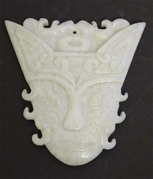 An Oriental carved hardstone pendant formed as a