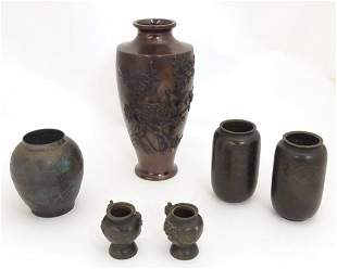 A quantity of Oriental cast vases comprising a baluster