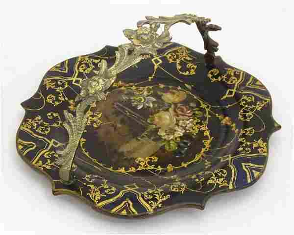 A Victorian papier mache dish with swing handle with