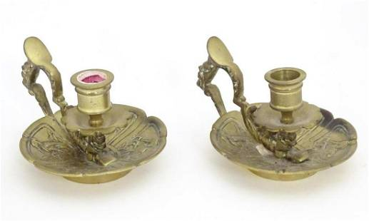 A pair of 19thC brass chambersticks with aesthetic bird