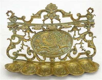 A 19thC brass pipe rack / stand with scrolling foliate
