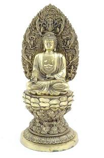 An Oriental brass model of seated Buddha on a stylised