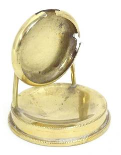 A late 19th / early 20thC brass pocket watch stand.