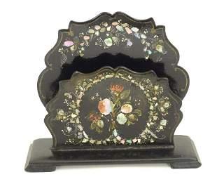 A Victorian papier mache desk letter rack of shaped
