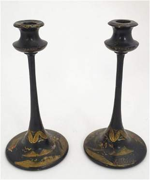 A pair of late 19thC lacquered candlesticks with