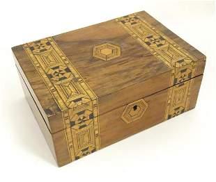 A Victorian walnut work box with geometric marquetry /