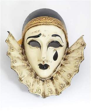 A Venetian Pierrot paper mache mask. Labels within for