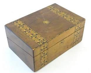 A 19thC walnut writing box with geometric marquetry /