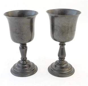 A matched pair of 19thC pewter pedestal cups / goblets.