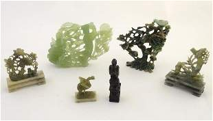 A quantity of Oriental soapstone carvings comprising a