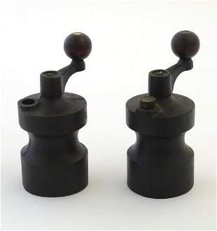 A pair of mid 20thC cast iron table salt & pepper