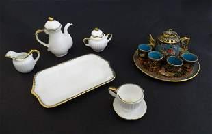 Toys: A ceramic doll's tea set, comprising coffee pot,