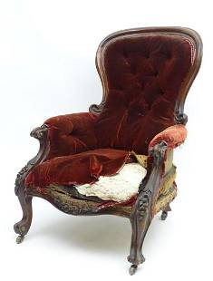 A Victorian mahogany button back armchair with a
