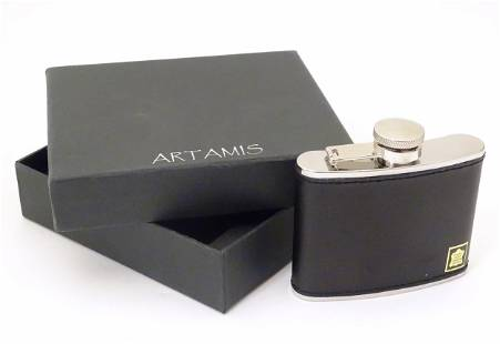 A boxed Artamis 4oz hip flask, steel with leather