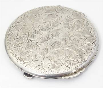 An American sterling silver compact with engraved